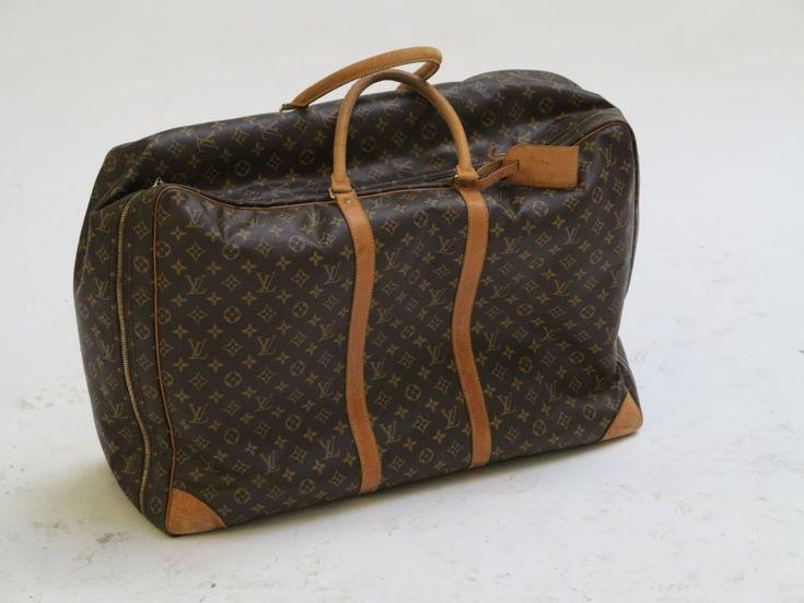 Louis Vuitton Petite valise souple en toile enduite monograllée et cuir naturel H: 47; L: 68; P: 16 cm - Millon & Associés - 10/10/2015