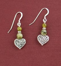 """Connemara Heart Scroll Earrings   These Connemara Marble Heart Scroll Earrings are handmade and imported from Dublin, Ireland. Made with sterling silver ear wires and measures approx. 1-1/2"""" in length. The artist, Sue Bowden, has been making jewelry in Dublin, Ireland for 20 years and travels extensively to source her stones and materials  Price: $24.95"""