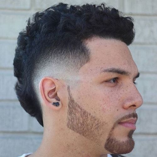 Clean fade with natural curly texture   Products: be curly shampoo and conditioner or invati, grooming clay,