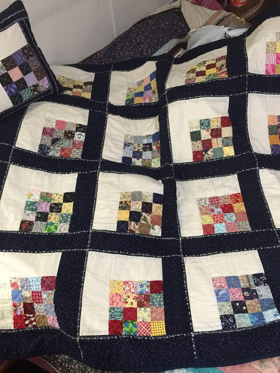 48x48 lap quilt. Pieced by machine and quilted by machine. Has two 14x14 matching pillows. Top is all cotton and muslin. Backing is muslin. Batting is cotton.