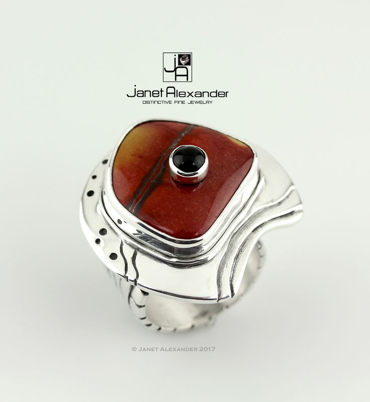 Carved fine silver (.999) ring with double stone. Bottom stone is 20 x17mm Agete and top stone is a 5mm round Onyx Size 7.5