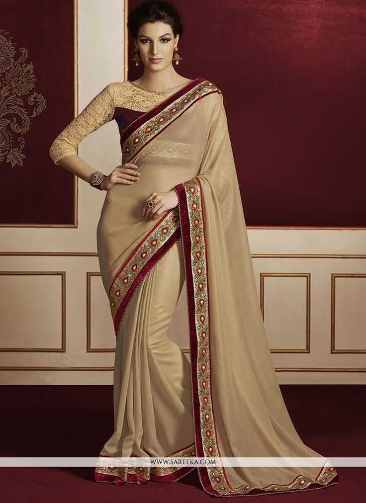 This season your look gets better definition with just a little attention to detail. Keep ahead in fashion with this cream georgette designer saree. The embroidered and patch border work looks chic an...