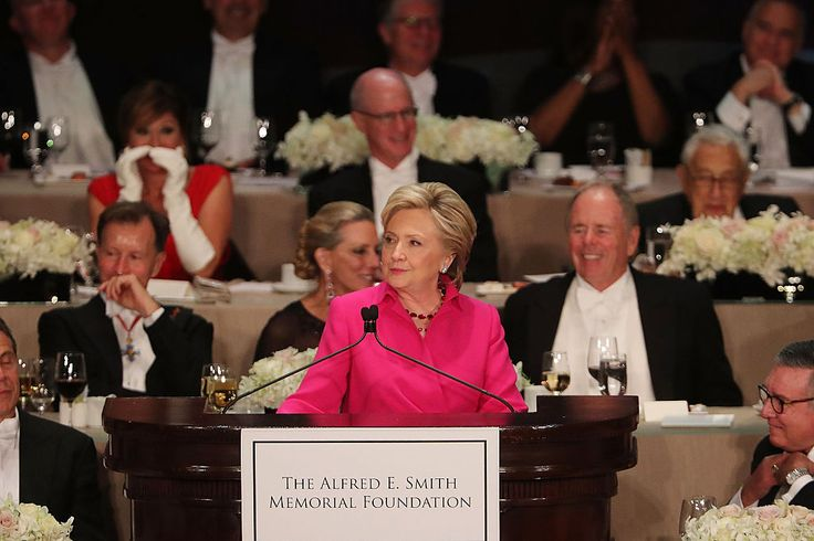 """This is one Hillary speech you simply must see.:-D Separated by only a priest from TrumpusGropus, Hillary clothed REALITY in a veneer of surgical humor to chop TrumpusMaximus off above the knees :-D LMFAO! :-D WHAT ARE THE ODDS THAT THERE'S ALREADY PLANS FOR AN """"IMPEACH CLINTON"""" ASSAULT IN THE MAKING? ShiningCityOnA.Hill? NOT The refusing to accept results of the election an EXTORTION (REAL voter fraud?) attempt using threat of Birther tactics? :-$ O:-) :-$ AmericanExceptionalism? NOT! :'("""