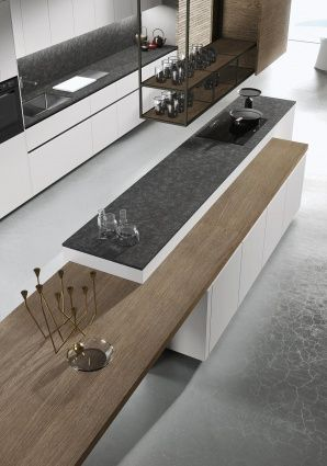 WOODEN COUNTERTOPS One of the distinctive features of Snaidero LOOK kitchen design is the wooden work top which can be placed over base units or used as a free-standing work surface. It is an independent surface, with adjustable height and width, the ideal element for a custom design. #SnaideroUSA | Michele Marcon Design
