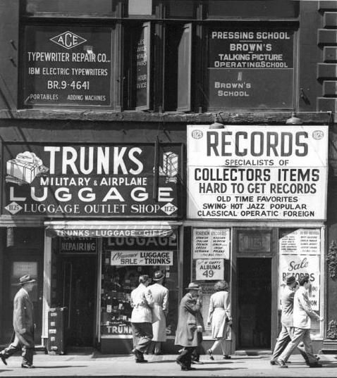NY 1948 | Photographer unknown - I find old signage that is crammed with info fascinating. The desperation in trying to communicate so much information on the front of a business in hopes of luring in business. It says Luggage 5 times on that storefront!: White Photography, Records Shops, April 23Rd, Sixth Void, York Cities, Records Stores, General Stores, Call Hard, 44Th Street