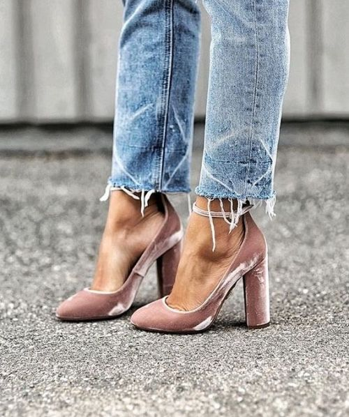 We're a fan of mixing edgy and feminine, a la ripped denim and velvet heels.