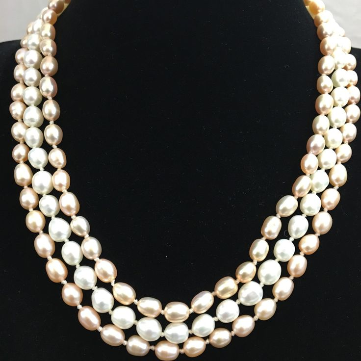 Three strands hand knotted fresh water pearls necklace. A forever gift for someone special.
