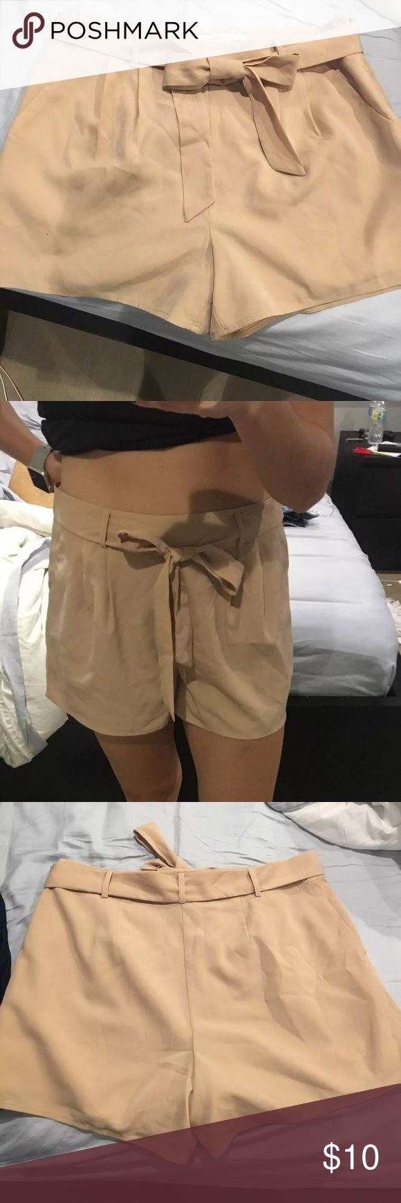 Pleated Nude Shorts Lauren Conrad size 10 high-waisted pleated nude shorts. They're too big on me and worn a few times. Material is so soft, 100% polyester. Shorts