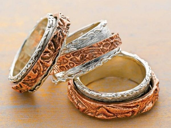 dual metal clay double spinner rings by Arlene Mornick - from Do You Know These Fun Ways to Use Metal Clay? Weaving, Cheetos, Even Knitting with Metal Clay! Plus 5 Expert Metal Clay Jewelry Making Tips - Jewelry Making Daily