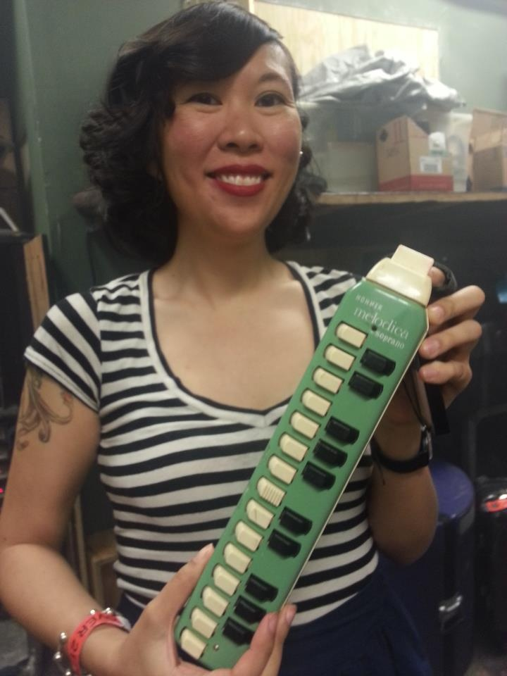 I took this photo last night at the show I went to in DC.  Emily Lee is a member of Stephen Brodsky's band (ex singer / guitar player of Cave In) and was playing this gorgeous Hohner Melodica. I just had to take a picture as the instrument and woman were so darn cute.