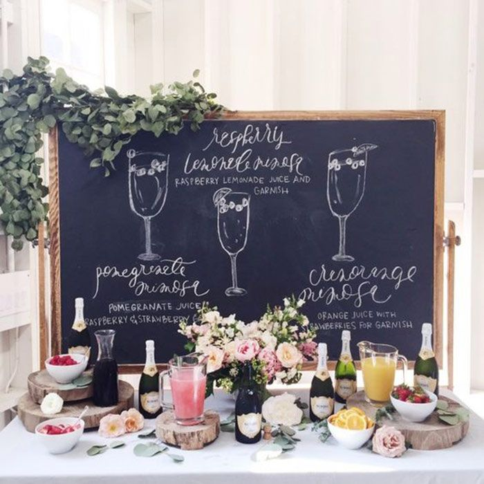 This chalkboard bar sign politely suggests how to mix it up at the champagne bar
