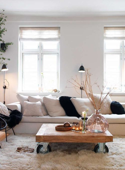 Danish Home via 79 Ideas. I love the faux fur rugh against the cart coffee table!
