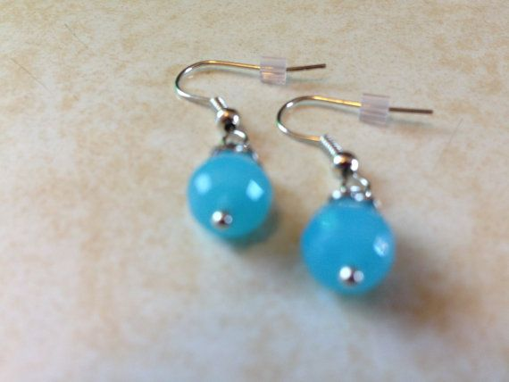 Love the pop of color in these subtle little earrings