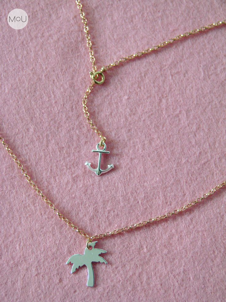 MOU Palm necklace with tiny anchor on the back. Entirely made of sterling silver, chain is also gold plated.