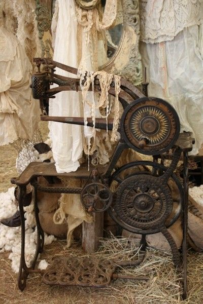 antique sewing machine and vintage laces...gorgeous