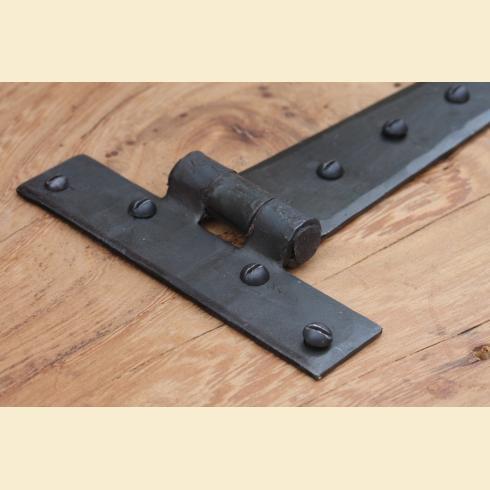 Close up of a T-Hinge http://www.priorsrec.co.uk/door-furniture/door-hinges/iron-door-hinges/c-p-0-0-3-31-48