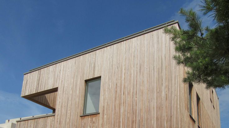 Modern house with a natural appearance on IJburg Amsterdam. Design by BNLA architecten