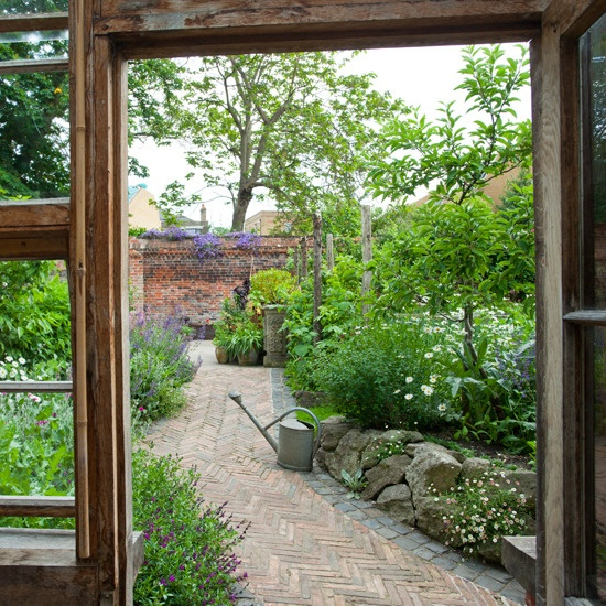 Curved garden path - leads the eye and makes the garden look bigger