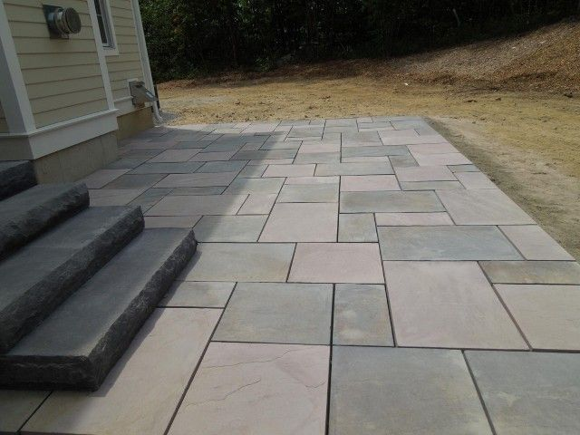 Create an eye catching entryway by using larger size pavingstones.