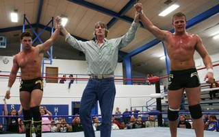 Ross (left) and Marshall Von Erich (right) appear with their father, Kevin Von Erich, at their WLW show at Sedan, Kansas, on April 20, 2012, where the Von Erich brothers faced Bryan Breaker and Jason Jones in a tag team match.
