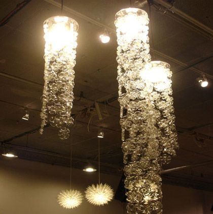 Beautiful flower decorations/chandeliers made from the bottoms of plastic soda bottles.