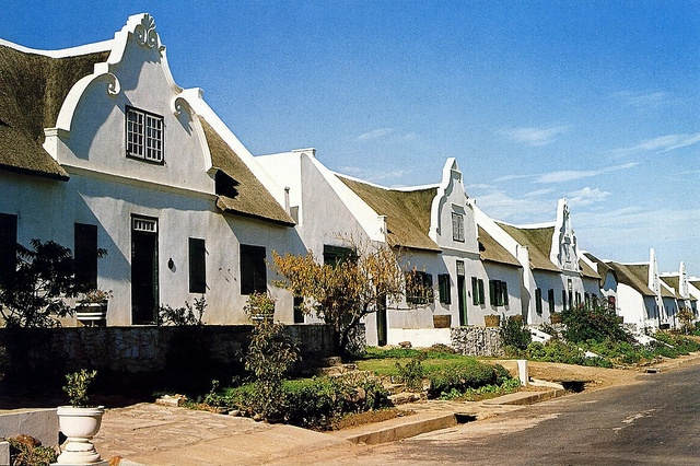 The picturesque street in Tulbagh is home to 32 historical buildings -  the highest concentration in the country. Many of the buildings were  severely damaged in an earthquake in 1969, but have been restored in  an extensive restoration project. The whole of the restored street has  been declared a national monument.