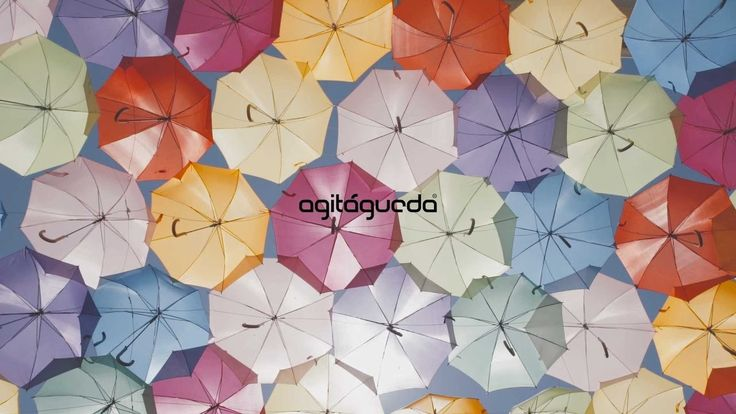 AgitÁgueda by Visit Portugal | Every year in July the city of Águeda bursts with colour and cheerfulness. Urban art, art installations, food and music shows – there's plenty to see at the AgitÁgueda Art Festival. The Umbrella Sky Project is one of its most well-known artistic projects.