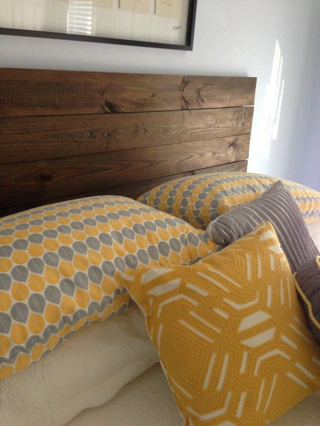 Connect several 1x6 boards together to make a custom headboard for about $60. | 27 Clever Projects Anyone Can Make With 2x4s