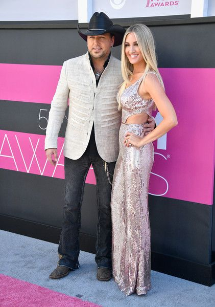 Jason Aldean Photos Photos - Recording artist Jason Aldean (L) and Brittany Kerr attend the 52nd Academy Of Country Music Awards at Toshiba Plaza on April 2, 2017 in Las Vegas, Nevada. - 52nd Academy of Country Music Awards - Arrivals