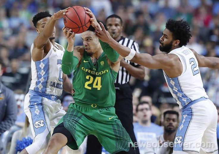 North Carolina's Nate Britt (0), left, and North Carolina's Joel Berry II (2) pressure Oregon's Dillon Brooks (24) during the first half of UNC's game against Oregon in NCAA Division I Men's Basketball Championship national semifinals at the University of Phoenix Stadium in Glendale, AZ, Saturday, April 1, 2017.