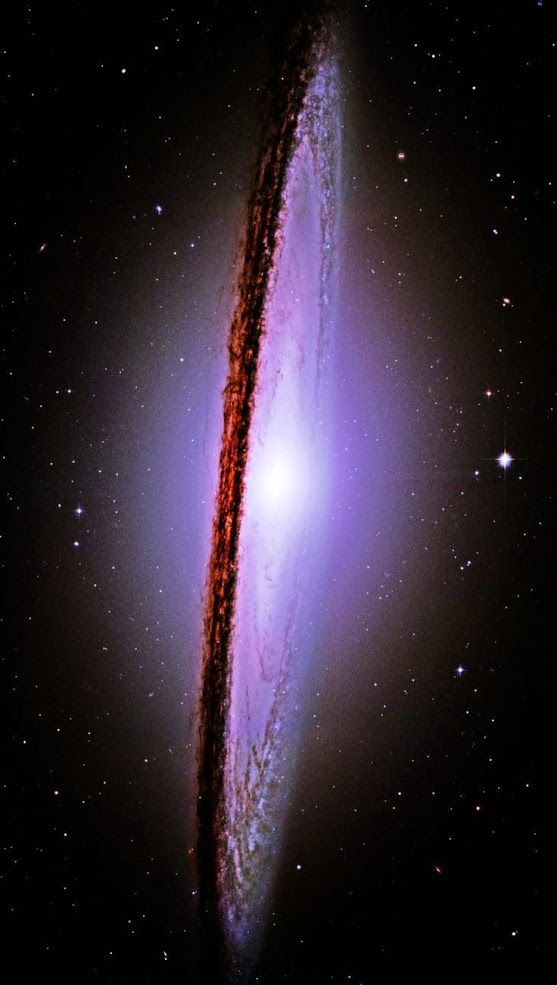 THE MAJESTIC MESSIER-104 (M-104) SOMBRERO GALAXY 28 million light years from earth and 50,ooo light years across . Photo By: NASA Hubble Space Telescope.