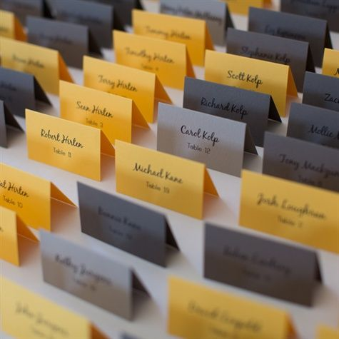 Different shades of yellow and gray escort cards. Nice for a fall wedding