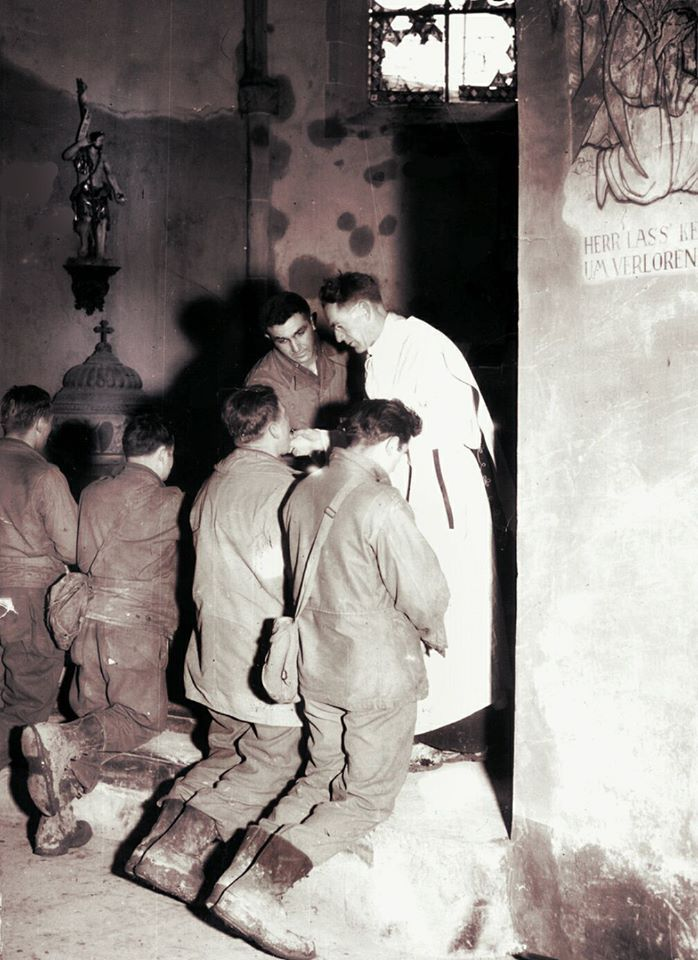 """WWII - February 26, 1945 Bliealf, Germany.  U.S. Soldiers receive the Eucharist at mass in a bombed out church.  Celebrant: Assistant Division Chaplain Father Sullivan. Altar server: Michael J. Migliaccio. Fourth """"Ivy"""" Division, Army Combat Engineers.  Honor the memory of men like these U.S. Soldiers upon whose broad shoulders we in the USA have too long relied for our liberty by following their example - Faith in the Line of Duty."""