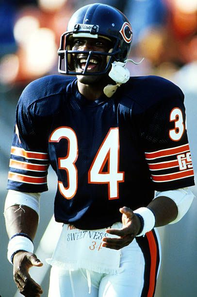 Running back Walter Payton of the Chicago Bears is having a good time on the sideline in a 27 to 9 win over the Minnesota Vikings on October 27 1985