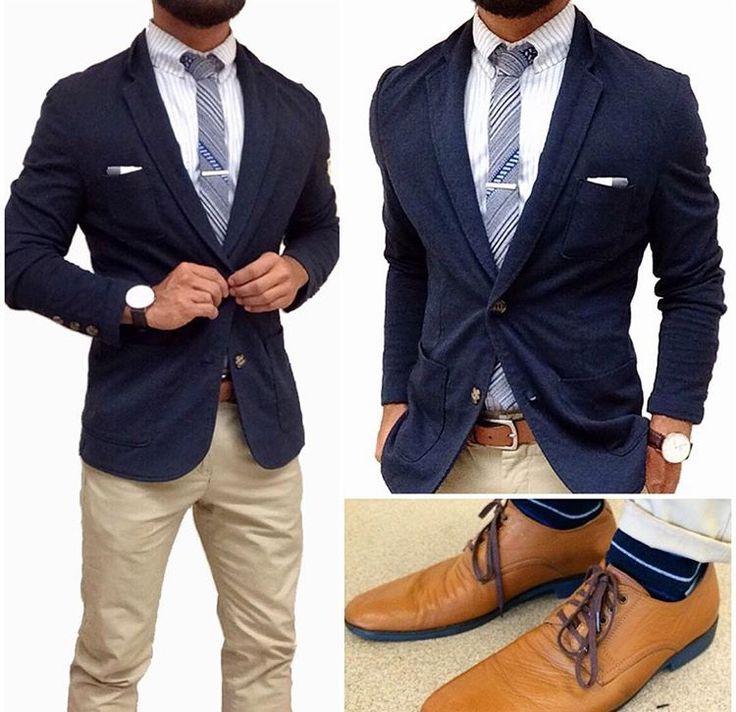 Navy blazer and cream trousers