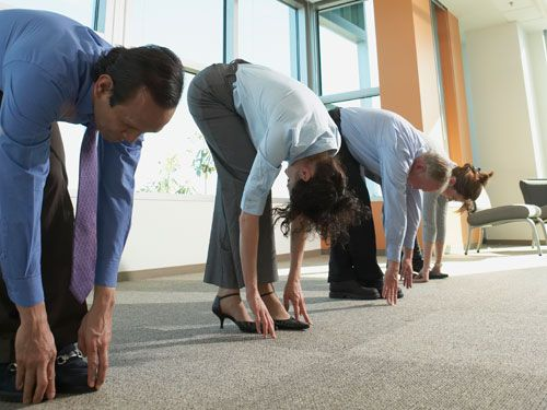 Want to relax and simultaneously make your co-workers uncomfortable? Try these 7 yoga moves for the office!