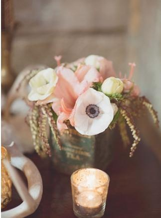 vintage wedding decoration idea: use old tin cans as vases.
