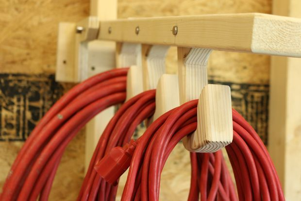 An easy way to store your extension cords without needing to reel them up or leave in a pile.