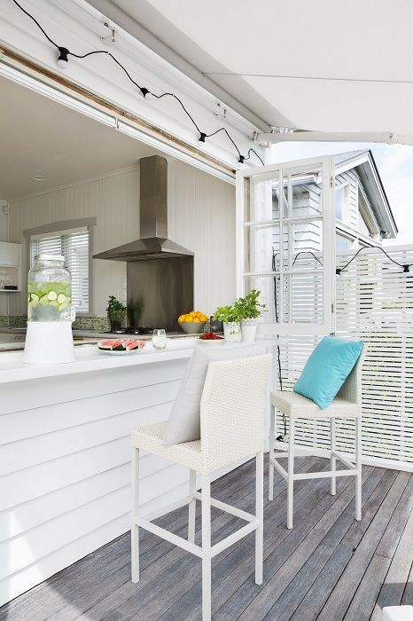 The final reveal! A light, fresh Scandinavian look was achieved by using Cabot's Deck & Exterior stain in Silver Beech colour on the decking timber.The retractable, motorised Mediterranean style awning was by Windoware in fabric, Docril colour 041. Decorating products are available in New Zealand through Guthrie Bowron stores.