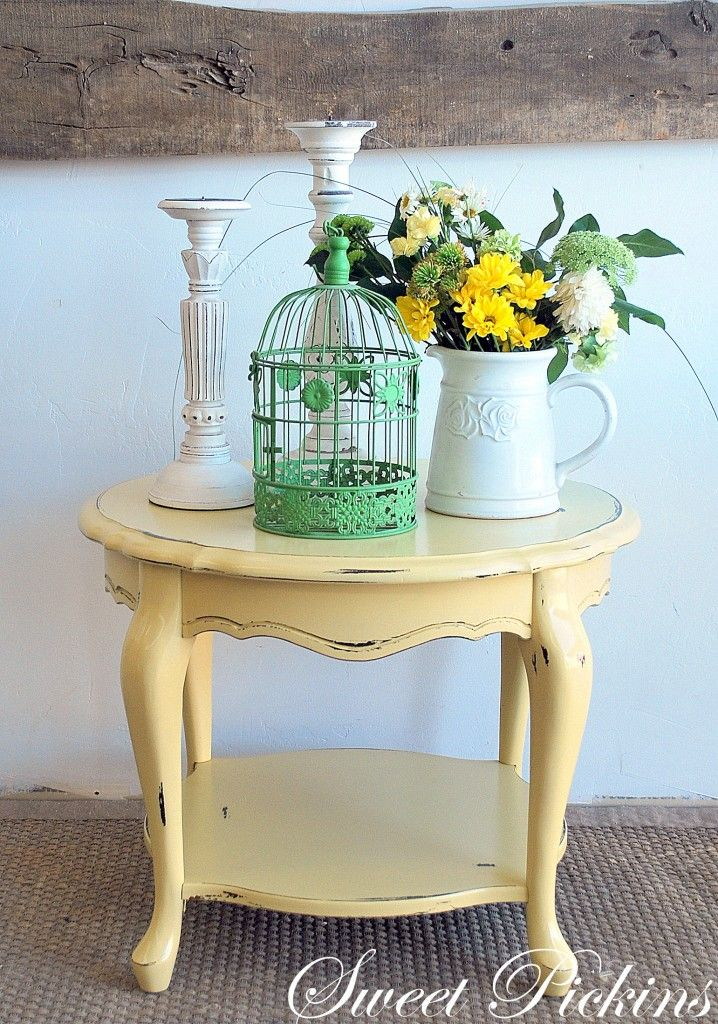 The cutest little scalloped side table…just a perfect shade of warm, buttery, sunshiney yellow, all bottled up in a paint can.  This perfect color is called White Raisin by Sherwin Williams.