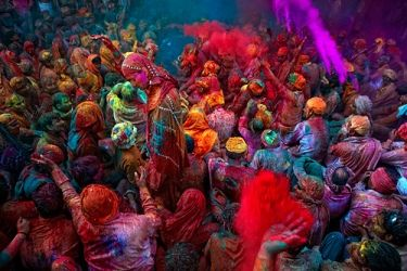 Holi Festival - India    A religious festival that occurs in the spring that closes the gaps between social classes and is celebrated by an outpouring of color.