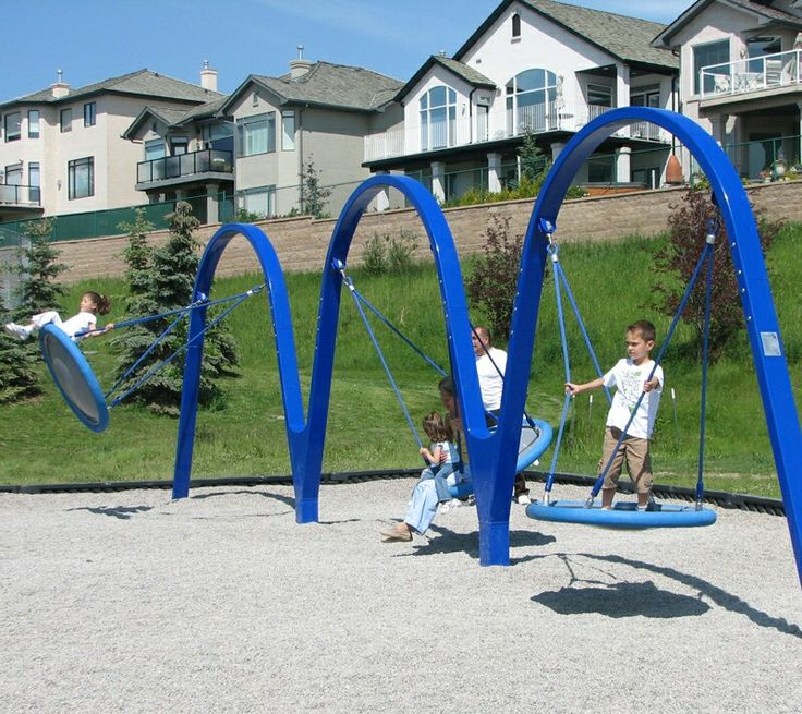 the biggo trio accessible swing set from dynamo playgrounds offers 3 large disc seats that each accommodate multiple kids