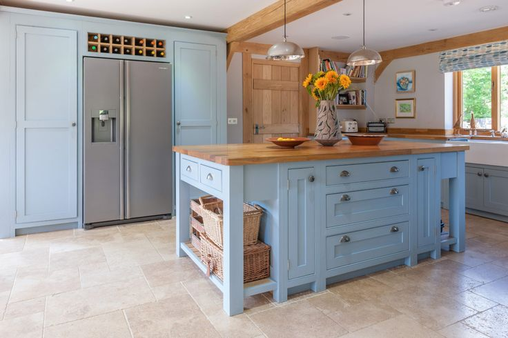 Beautiful oak frame kitchen from Welsh Oak Frame with exposed oak beams. Oak frame has been kept quite minimal however adds character to the kitchen.  www.welshoakframe.com #paintedkitchen #oakframe #kitchenideas #modernkitchen
