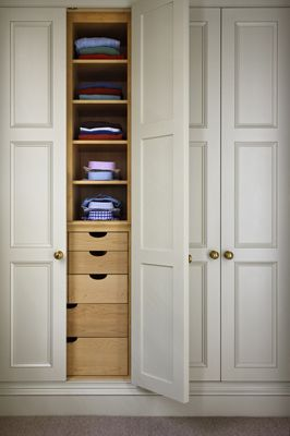 Closet doors + drawers. I would love a wall of storage like this. It reminds me of my Grandma's. She had an awesome hallway of storage, and you never knew what kind of goodies you'd find in there.