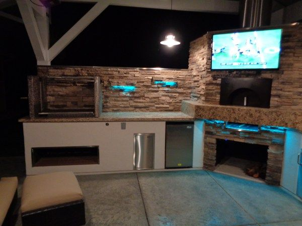 This Custom Outdoor Kitchen Features Fire Magic Appliances, A Custom Santa  Maria Grill And Industrial Swivel Bar Stools Built By Leasure Concepts. The  Pizza ... Part 50