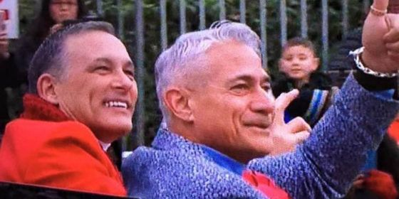First openly gay grand marshal Greg Louganis rides in Rose Parade with husband