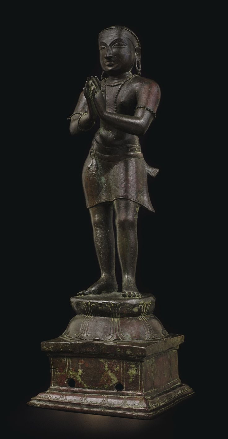 AN ELEGANT BRONZE FIGURE OF APPAR Southern India, circa 13th Century