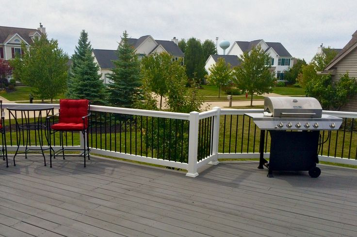 Brighten up your deck area with the unique look of vinyl railing with aluminum spindles.