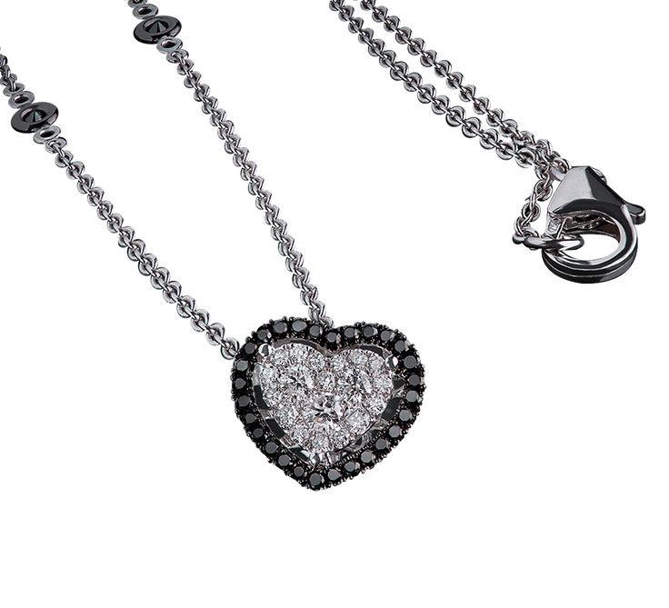 Привлекательная подвеска в форме сердца. Очаровательное бриллиантовое сердце – самый романтичный подарок, которого заслуживает Ваша любимая. Украшение выглядит очень изыскано и элегантно. Предлагаем Вашему вниманию другие украшения этой же ювелирной марки.