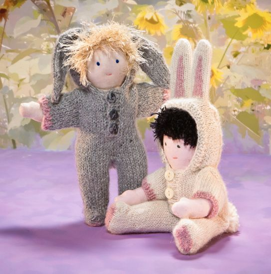 Sewn dolls, knitted costumes--love the ears on these bunnies!